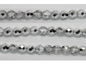 30 perles verre facettes demi-argent 6mm