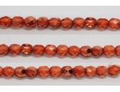 30 perles verre facettes orange fonce demi metalise 6mm
