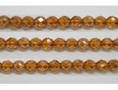 60 perles verre facettes topaze fonce lustre 4mm