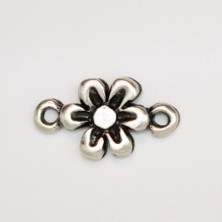 50 fleurs metal argenté antique 18x11x2mm